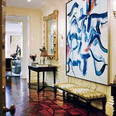 Valentino's NY apartment. Willem de Kooning's Untitled XIV (1982) hangs above a hard-stone-inlaid, ebonized Napoleon III banquette; at left, an 18th-century faience lion sits on a 19th-century marquetry table, in front of a 19th-century Italian geometric mirror.