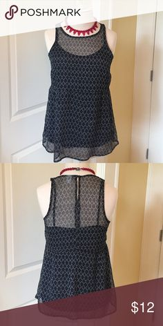 Old Navy layered peplum top Black and white peplum top with camo insert. Keyhole closure in back at neck. Wear dressy or casual! Old Navy Tops