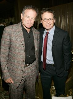 ".Robin Williams, left, and Michael J. Fox during ""A Funny Thing Happened on the Way to Cure Parkinson's ..."" benefiting the Michael J. Fox Foundation for Parkinson's Research at the Waldorf Astoria in New York City in 2004 KMazur—WireImage/Getty Images"