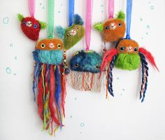Spirit Fish Bears 2010. colorful mixed mohair and yarns. Wear as a necklace or hang as a charm/ ornament. by Peng Peng