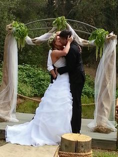 Kiss under the archway at our bayou themed wedding! :)