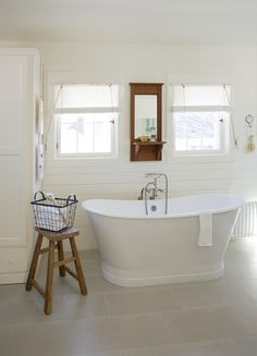 Bath in modern farmhouse-mostly white with touches of wood for a rustic edge