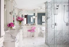 love the pops of pink with the gray and white of the walls, cabinetry, and marble