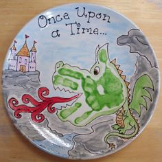 Handprint Dragon craft for kids on a plate