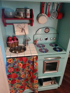 Jim and I made this play kitchen for our grandaughter London. It's an entertainment center. The oven door opens and the sink is a dog bowl we bought from our local Tractor Supply here in Woodstock Virginia.