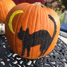 Black cat pumpkin done with sand.  Moon is puffy paint.