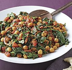 Spinach+and+Chickpea+Curry from Fine Cooking. Though listed as a side dish, I would serve this over rice as a meal. #celebrateveggies