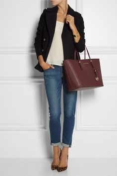 Jeans, white vest, black jacket & Michael Kors bag.