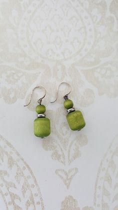 """Finnish vintage hook earrings made by Aarikka. This model is named """"Taiga"""" and it is presented in the 1996 Aarikka catalog. The hook is probably silver, not marked. Vintage Hooks, Retro Vintage, Etsy Earrings, Drop Earrings, Wood And Metal, Crochet Earrings, Silver, Jewelry, Jewlery"""