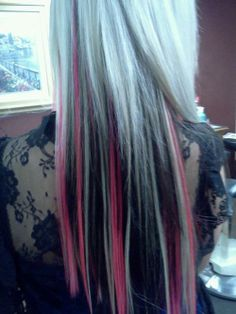 Blonde hair with black and pink highlights