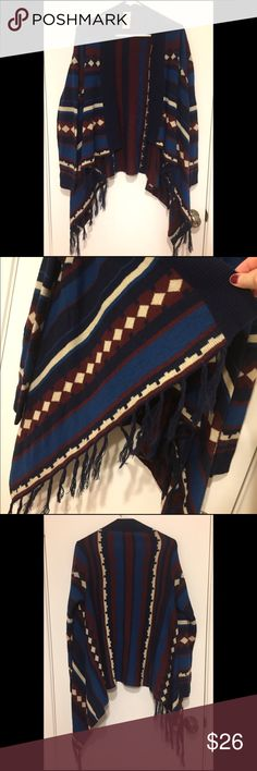 Tribal Print Tassel Sweater Great to wear with leggings and boots. Nice and easy to thrown on. Still in great condition. Sweaters