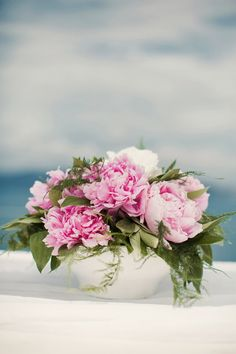 Pink peonies centerpiece ~ Romantic Destination Wedding in Santorini, Greece ~ Anna Roussos Photography | bellethemagazine.com
