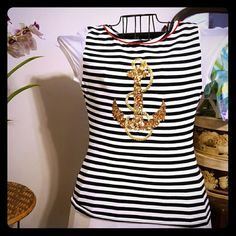 Cute nautical top with sequins Red, white and black with gold threading looks like a rope and gold sequins in the shape of an anchor, white mesh cap sleeves.The top is very stretchy. From Italy. Like New! Casca Della Spiga Tops Blouses