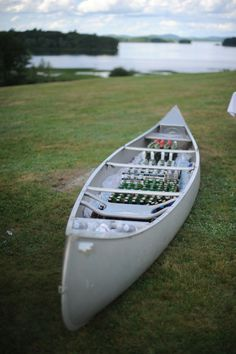 This is an amazing idea for serving drinks at a lakeside vow renewal