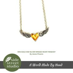 """MINI GOLD AND SILVER WINGED HEART PENDANT.  """"A heart with wings is a symbol that reminds us to stay connected to our heart's true path"""". Jessie Phoenix.  A handmade sterling silver necklace featuring a silver heart with gold leaf inside centred between wings on a silver chain.   The wingspan of the heart with wings measures 1.5"""" (4 cm) and the chain measure approximately 18"""" in length."""