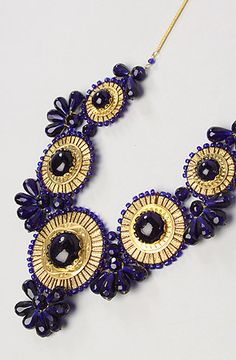 The Medallion Bib Necklace in Navy by *Accessories Boutique