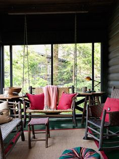 Rustic Log Porch The owners of this Michigan cabin used sturdy chains and hooks to turn a bench into a swing