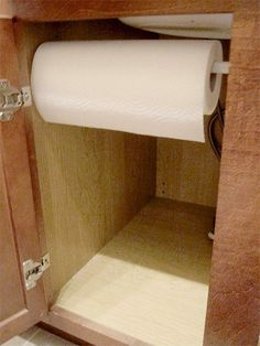 Tension rod for paper towels