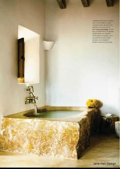Rustic style bathroom with warm parchment walls