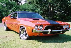 1973 Dodge Challenger. Love this! My Dad got me this for my first car. It was blue with a black vinyl top. Miss it!