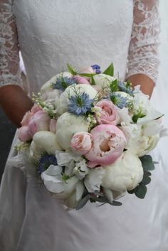 Bridal bouquet included a collection of Peonies 'Angel Cheeks' and 'Duchesse De Nemours' with Nigella 'Love in the Mist', fresh Lily of the Valley, Sweet Peas, English Garden Roses Patience, White Ohara & Bombastic with Forget Me Nots and Eucalyptus foliages