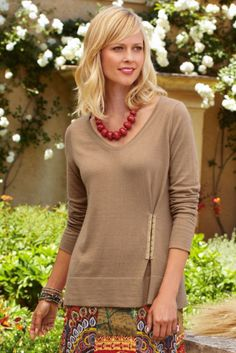 Hook and eyes to take in a sweater for better fit--cute. Could also be a button loop or zipper.