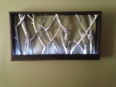 Pallet wood, branches and LED lights, put together by the Reuse Dude.