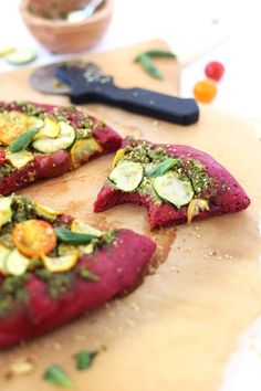 Vegan BEET crust pizza dough with homemade lemony pesto and fresh veggies. Easy to make, super flavorful and gorgeous to look at!