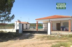 Property Ref: W3965 Country house with a very large plot for sale in the town of Ayora (Valencia).The property offers a very spacious car port and porch, living/ dining room, kitchen, 1 bedroom, 1bathroom, chimeney. patio area with BBQ, small store room with gas hot water boiler.This is all surrounded by security fencing with large sliding entrance gates.There is an olive plantation on the other side of the road. An internal viewing is recommended Price: 120.000€