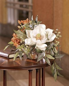Southern Charm Silk Flower Arrangement, magnolia bloom, rust colored alstromeria, green garbanzo beans and smilax leaves. Beautiful fall decor or display all year! Silk Floral Arrangements, Artificial Flower Arrangements, Beautiful Flower Arrangements, Wedding Flower Arrangements, Floral Centerpieces, Table Centerpieces, Beautiful Flowers, Wedding Flowers, Table Arrangements
