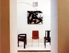 The chair on the left is Pigreco. It was designed by Tobia Scarpa and Emilio Mantese about 1956. The middle chair is Lambda, designed by Marco Zanuso and  Richard Sapper in 1960. The chair on the right is Lierna which was produced by Studio Gavina for Armstrong in 1956/57. It was produced by Gavina working on instructions from Pier Giacomo Castiglioni. The lamp is the famous Arco