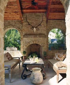 Porch w/ stone fireplace, cedar planking, and otomi pillows; Eleanor Cummings