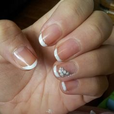 So i dod my own nails to zave on money n how i did these lovely nails is i rounded them with a file...then i used a bandaid put the round part right below the tip of my nail n used white nail polish... painted the tip n removed the bandaid...i also got those sticker nail flowers put one on each hand...n topped it off with clear nail polish...super easy n they look like i got them done