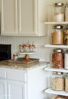 We love the look of these DIY Country Store Kitchen shelves - and the gorgeous glass jars lining them - for your Century Communities Charlotte kitchen! Floating Shelf With Drawer, Floating Shelves Bedroom, White Floating Shelves, Floating Shelves Kitchen, Rustic Floating Shelves, Kitchen Shelves, Kitchen Redo, Kitchen Pantry, Glass Shelves