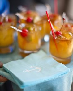 Mini Mai Tais were garnished with cherries and served with nautical napkins.