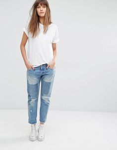13e3a503639 Shop Levi's 501 CT Mid Rise Tapered Leg Jeans with Patches at ASOS. Doriana  Grey · Denim Fantasy