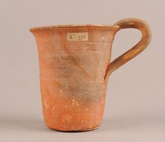 Tall straight-sided pottery cup. Orange slipped inside and out. Culture/periodMiddle Minoan IIB term detailsMiddle Minoan IIIA term details Date1800BC-1650BC Production placeMade in: Crete term details(Europe,Greece,Crete) FindspotExcavated/Findspot: Knossos(Europe,Greece,Crete,Knossos) Materialspottery term details Techniqueslipped term details DimensionsHeight: 11 centimetresWidth: 11.9 centimetresWeight: 142 grammes