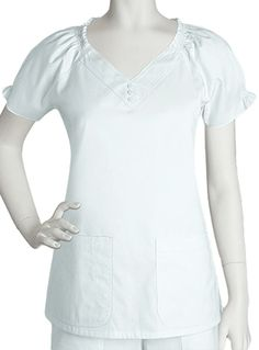 Style Code: This Barco Prima top has elastic shirring at neckline for added comfort. It further features two pockets, plain back and inches of center back length. It is made with cotton and polyester fabrics and is available in sizes XS to White Scrub Tops, Maternity Scrubs, Nursing Tops, Designer Dresses, Looks Great, Nurse Uniforms, Tunic Tops, Pocket, Neckline