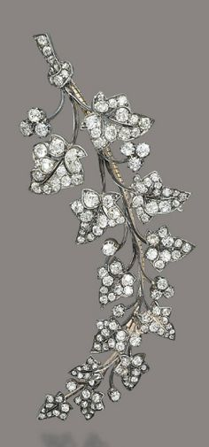 TWO ANTIQUE DIAMOND BROOCHES   Designed as a larger and a smaller branch of ivy leaves, the larger one with a tied ribbon at the base, both set throughout with old-cut diamonds, spring adapted, mounted in silver and gold, circa 1870, 12.8 and 9.6 cm