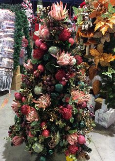 Australian Christmas tree decorated with faux Australian native flowers.