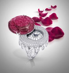 Remarkable Rubellite - A stunning carved rubellite secret watch ring combines the allure of a carved gemstone with the drama of magnificent diamonds, the delicate carved jewel seamlessly slides aside to reveal a timepiece beneath. #GraffDiamonds #OneOfAKind
