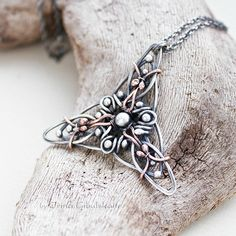 Triquetra  Sterling silver Pendant with copper by Taniri on Etsy, €68.00