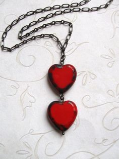 Two Red Hearts Necklace - glass heart beads with gunmetal chain