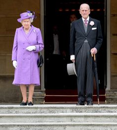 The Queen wearing a matching lavender coat and dress designed by Angela Kelly while Prince Philip, Duke of Edinburgh were dressed up for the occasion as well during the first garden party of the season in the grounds of Buckingham Palace on 21.05. 2014 in London, England.