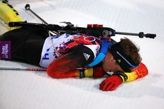 Simon Schempp of Germany collapses in the snow after the Men's Individual 20 km (c) Getty Images The Man, Forget, Germany, Snow, Biathlon, Deutsch, Eyes