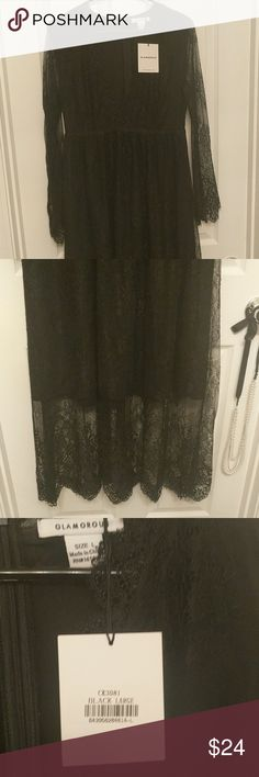 NWT black lace v-neck maxi dress! Black lace zip back dress with sheer arms. The lower part of the maxi dress is also sheer. glamorous Dresses Maxi