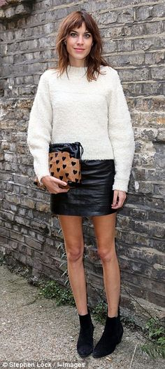 Alexa Chung in Topshop sweater, Burberry clutch - London Fashion Week. (September 2013)