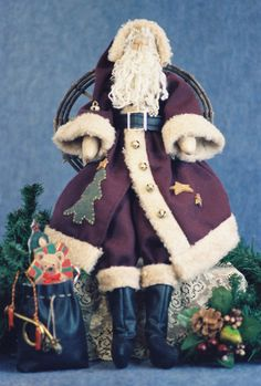 24 Santa (match with Mrs. Claus FH-35Etsy for a Christmas couple. Pattern sold separately) Body is muslin. Face is sculpted. Boots & belt are vinyl. Coat and boots are trimmed with shaggy Plush Felt. Beard is wool. Coat adorned felt tree applique, small jingle bells & wood stars. Intermediate and