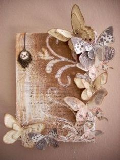 Make butterflies out of old book pages