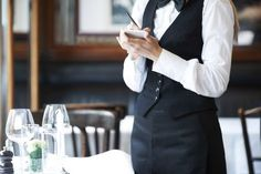 """""""The No-Tipping Point""""   Freakonomics """"Front-of-the-house"""" employees are making plenty of money, but because their money comes primarily out of the customers' pockets via tips, it can't be redistributed to where it's needed: in the kitchen to retain staff."""" (photo:Yuri Arcurs/Getty Images)"""
